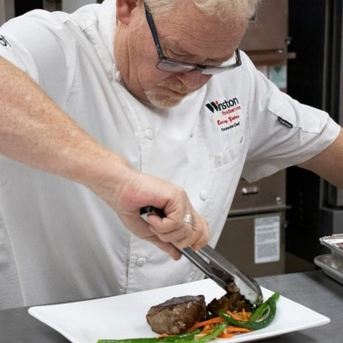 Chef Barry plates a steak