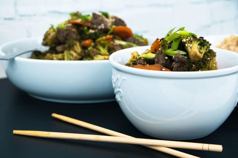 beef and broccoli with chopsticks